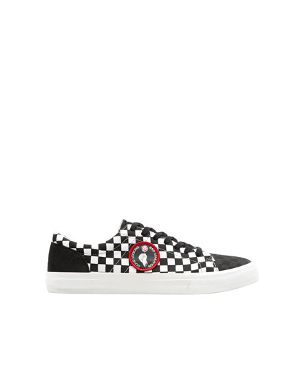 Tennis écusson damier