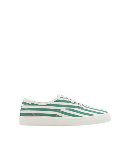 Green and white striped sneakers