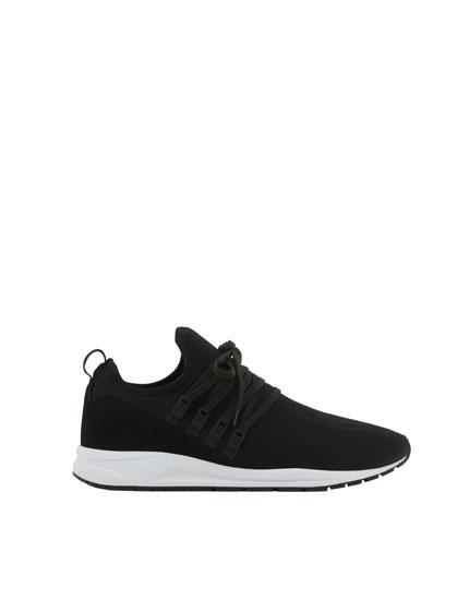 Sneaker mit elastischem Schaft und Stickerei