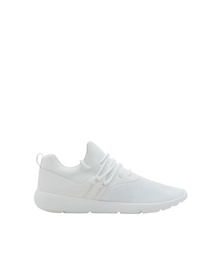 All-white sock-style sneakers