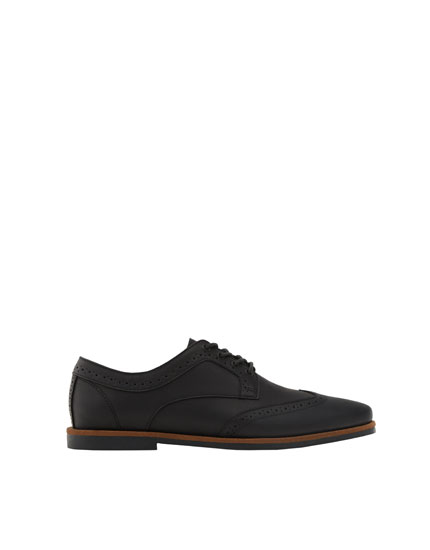 Slim black brogues