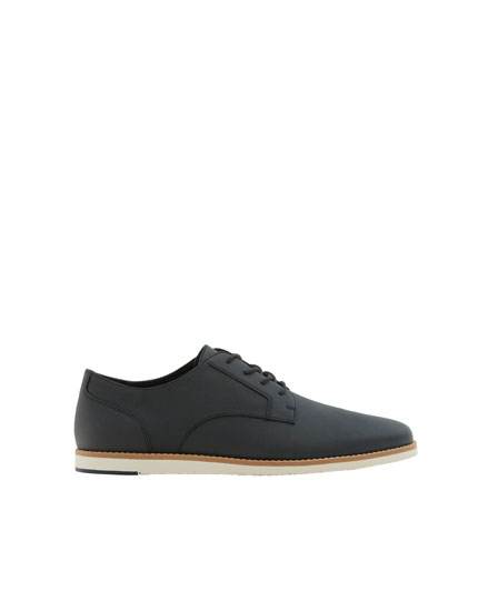 Slim blue shoes with welt detail
