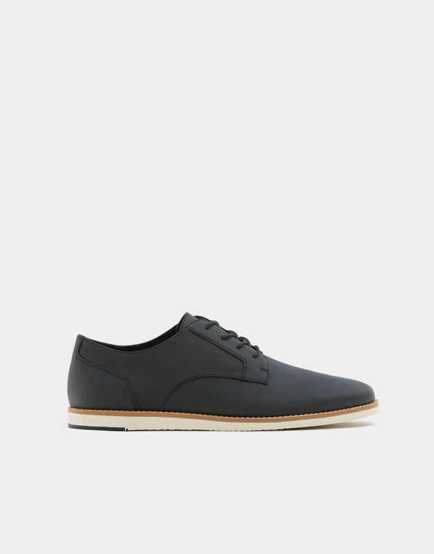 Slim blue shoes with welt detail ...