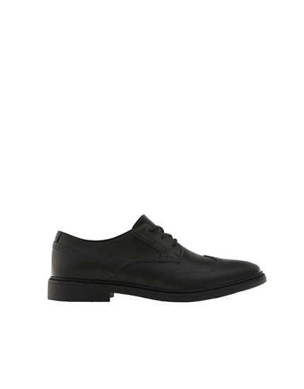 Smart black brogues