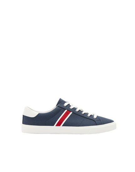 Blue canvas sneakers with stripe detail