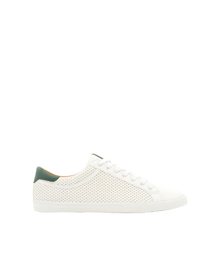 Die-cut sneakers with green details
