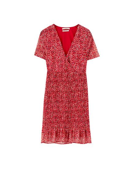 Mini dress with smocked skirt