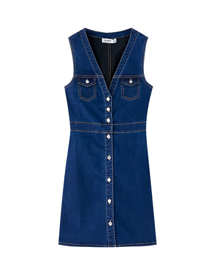Short denim dress with pockets
