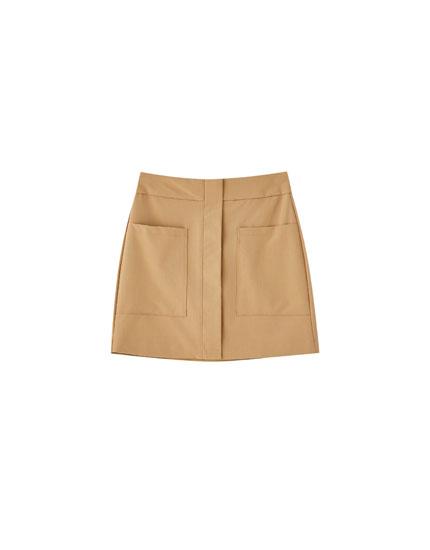 Minijupe marron poches plaquées