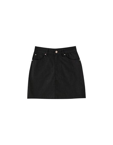 Textured five-pocket mini skirt