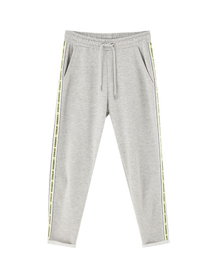 Joggers with slogan taping