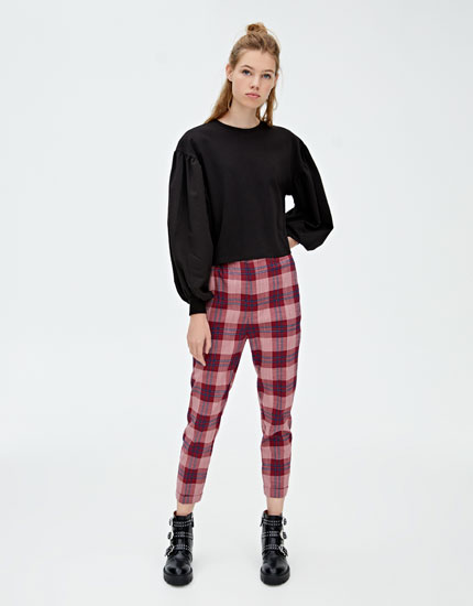 Checked trousers with turn-up hems