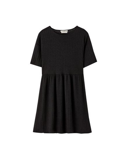 Zwarte babydoll mini-jurk
