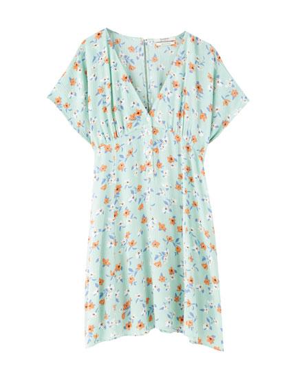 Mini-kjole med blomsterprint og slidser i siden
