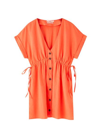 Korte koraalrode jurk