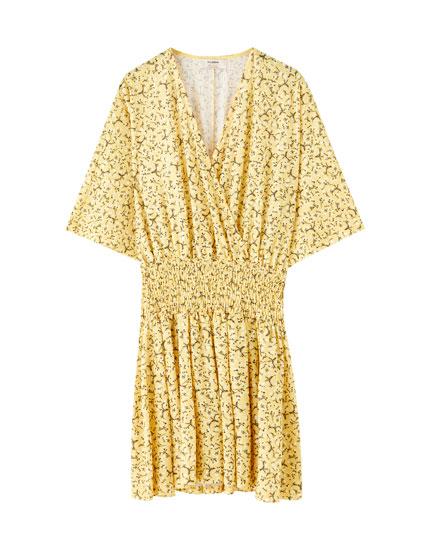 Mini dress with gathered waist
