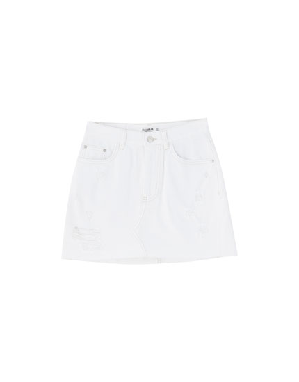 White mini skirt with rips
