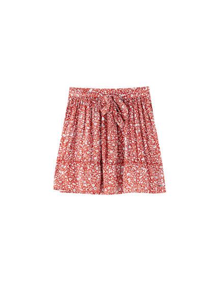 Minifalda flores rojas lazo