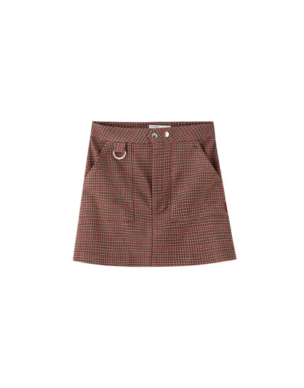 Check mini skirt with ring