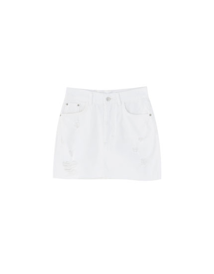 Ripped white denim mini skirt
