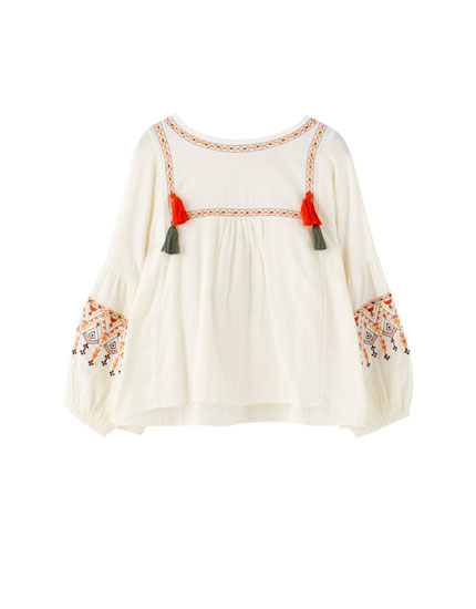 White oversized blouse with embroidery