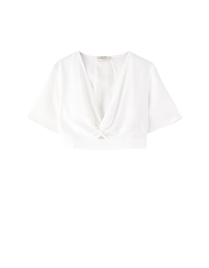 White blouse with decorative knot