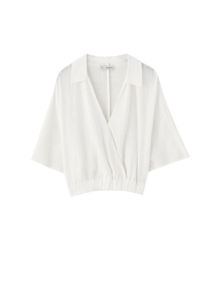 White wrap shirt with elasticated hem