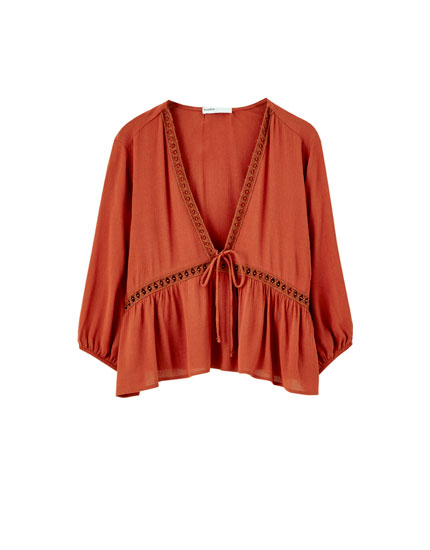 Lace-trimmed crepe top