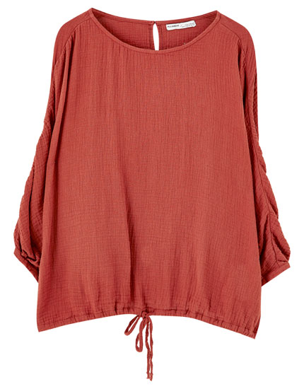 Oversized blouse with drawstrings