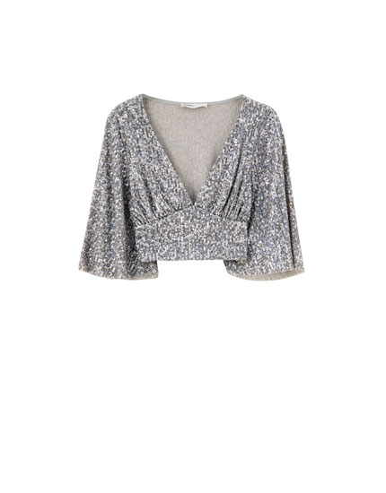 Sequinned top with bell sleeves