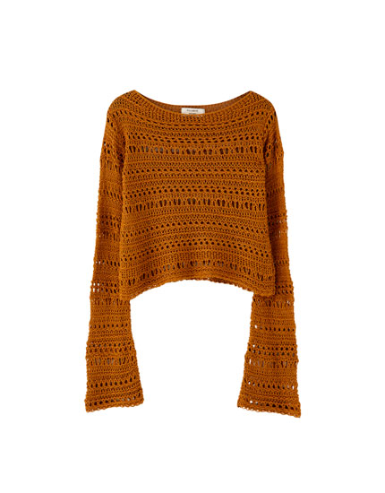 Open-knit sweater with flared sleeves
