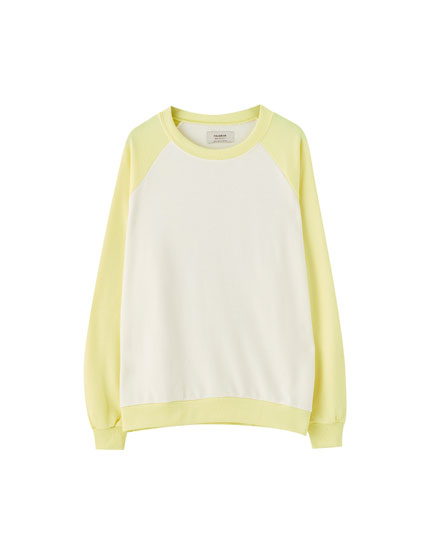 White sweatshirt with yellow sleeves