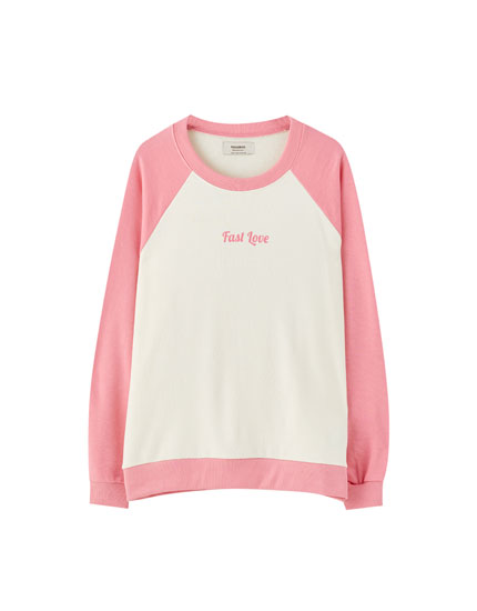 White sweatshirt with pink sleeves