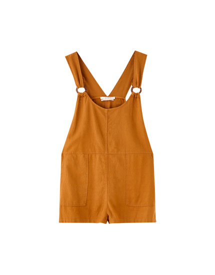 Rustic pinafore dress with eyelets