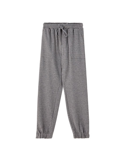 Jogging trousers with elasticated hems