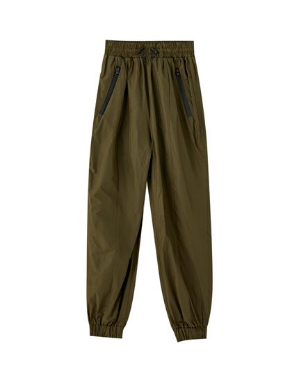 Nylon trousers with elastic hems