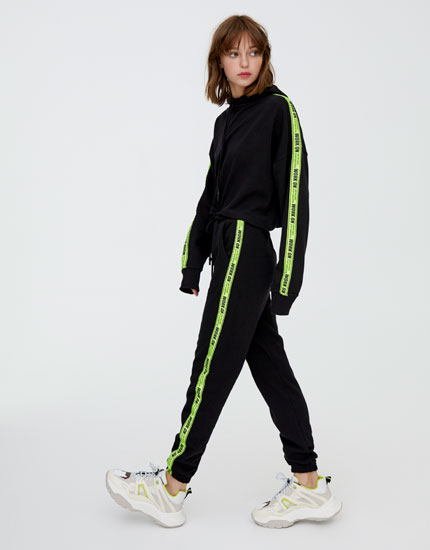 Joggers with slogan side stripes