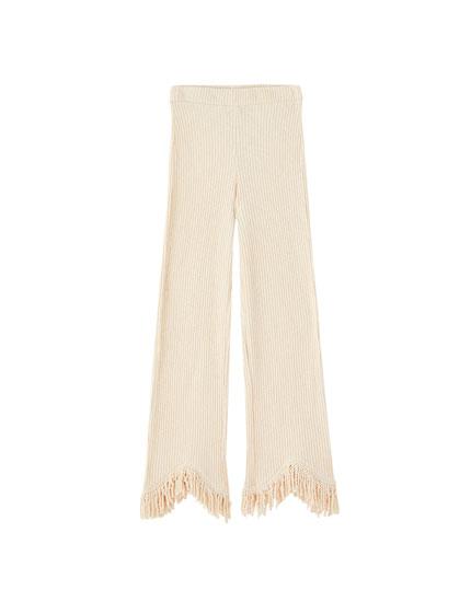 Pantalon côtelé bas frangé