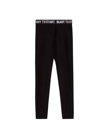 Black leggings with slogan-printed waistband