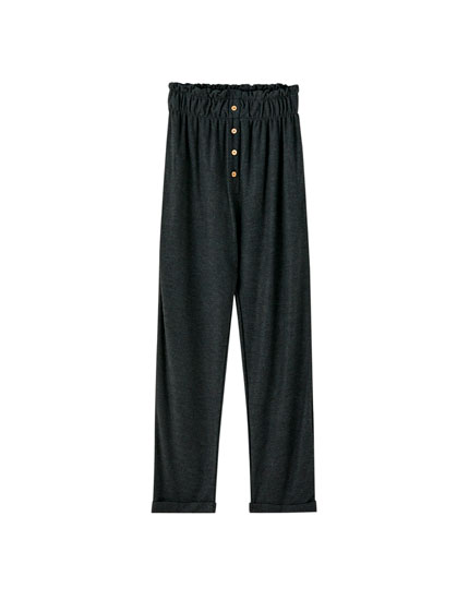 Paperbag trousers with visible buttons