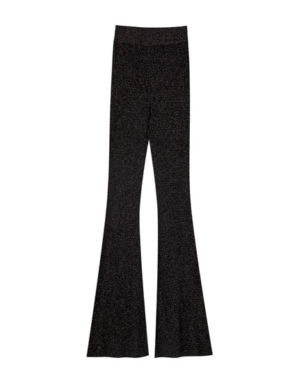 Flared black trousers with shiny detailing