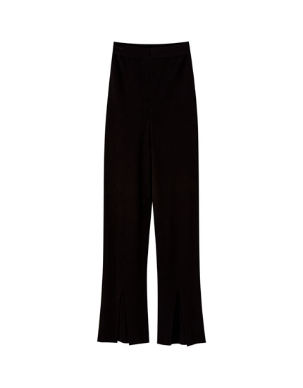 Flared trousers with slits