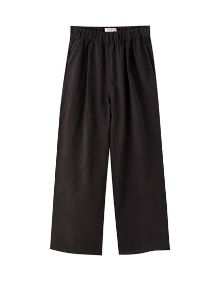 Pantalons culotte baixos amples