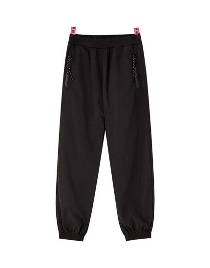 Rosalía black cargo trousers