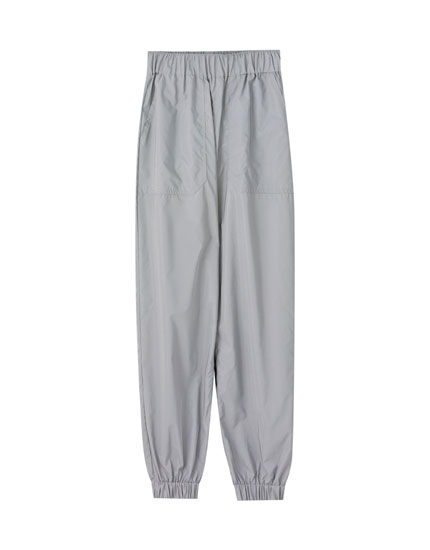 Reflective grey trousers