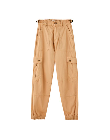 Cargo trousers with pockets and elasticated hems