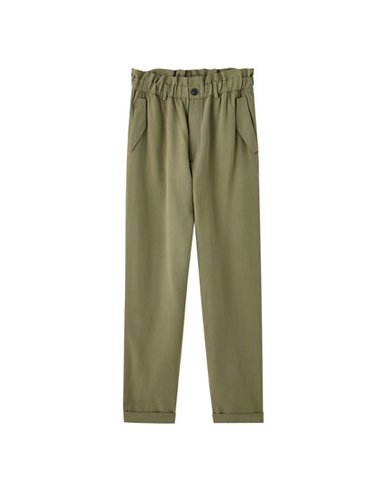 Elastic waist trousers with flaps