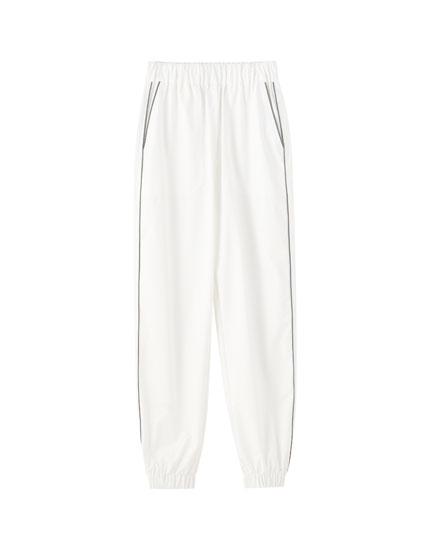 White reflective trousers