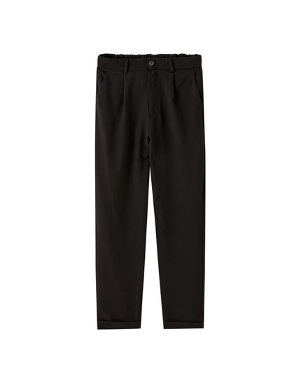 Black tailored trousers with darts