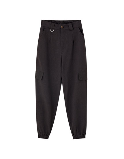 Grey cargo trousers with U-shaped metal ring detail